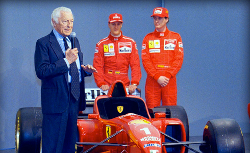 The Avvocato presents the New Ferrari 310  model, in 1986.  With him the FI drivers Michael Schumacher and Eddie Irvine.
